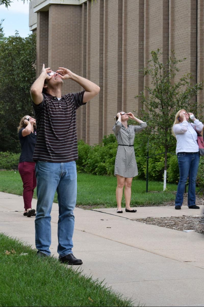 SVMBS faculty and staff watch the eclipse progress.