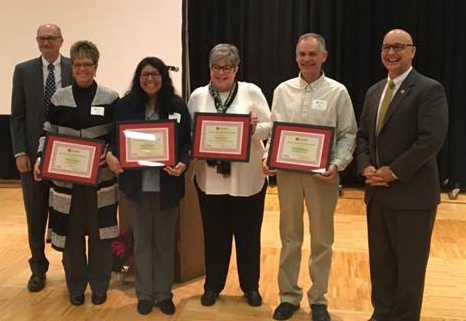Patricia Neben (left), Catia Guerrero, Gentry Lewis and Bob Hendrickson receive their awards from IANR Associate Vice Chancellor Ron Yoder and IANR Harlan Vice Chancellor Mike Boehm
