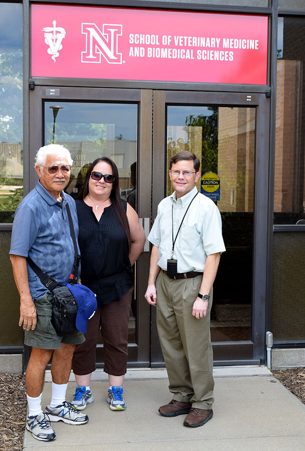 Dr. Robert Nakamura, his daughter Ann Balala and Dr. Rodney Moxley pose outside of the School of Veterinary Medicine and Biomedical Sciences