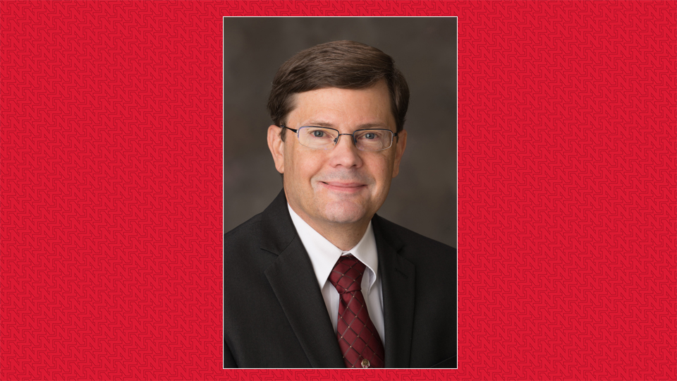 Photo of Dr. Rodney Moxley on a red background